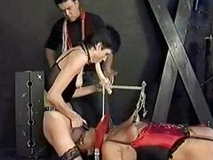 Ebony slave tied to a..