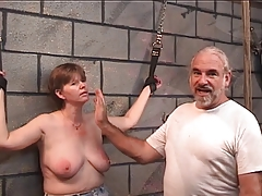 Slave gets leather cuffs..